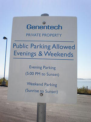A parking sign on the Genentech headquarters c...