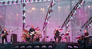 "Turn It On Again: The Tour - Genesis performing ""Hold on My Heart"" at Old Trafford, Manchester, UK."