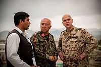 German air force Brig. Gen. Gunter Katz, right, an International Security Assistance Force spokesman, surveys the grounds at the Afghan National Defense University (ANDU) in Kabul, Afghanistan, May 7, 2013 130507-F-OF869-001