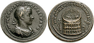 Colossus of Nero - Gordianus III medallion showing MVNIFICENTIA GORDIANI AVG, bull contending with elephant within the Colosseum, seen from above; Colossus of Nero and Meta Sudans, and the Temple of Venus and Rome, or the Ludus Magnus on either side.
