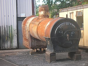 Round-topped boiler - Round-topped boiler from 'Austerity' saddle tank locomotive 3809, removed for overhaul. The 'waisted' firebox is at the far end of the boiler