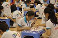 Guinness World Record 2011 - Largest Jigsaw puzzle - most pieces (students in progress 6).jpg