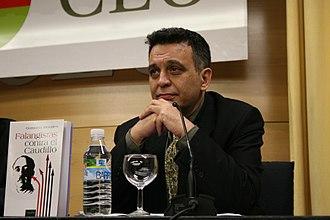 Gustavo Morales - Delgado at a presentation of one of his books