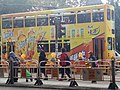 HK 銅鑼灣 Causeway Bay Rpaf tram body ads Tangyi Dr Kong Ice tea 康師傅 yellow no 100 December 2016 Lnv2.jpg