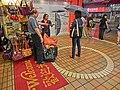 HK Kwun Tong Ngau Tau Kok Road 裕民薈商場 U-Mall 裕民中心 Yue Man Centre shop umbrella Rain visitors red welcome carpet April 2013.JPG