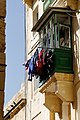 Hanging laundry oriel window Valletta.jpg