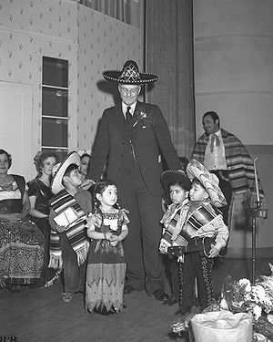 Harry Chandler - Harry Chandler, publisher of The Los Angeles Times, greeting from Olvera Street children, 1938.