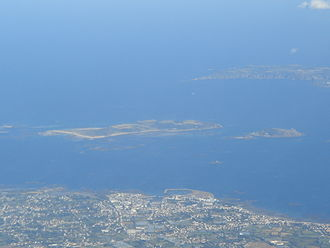 Herm - An aerial shot showing Herm (centre), Jethou to the right, Sark in the right background and Guernsey in the foreground
