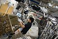 ISS-49 Takuya Onishi with the Group Combustion Module in the Kibo lab.jpg