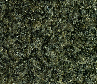 "Bushveld Igneous Complex - Gabbro-norite (polished slab), marketed as ""Impala Black Granite"", Bushveld Complex. It is composed principally of grayish plagioclase feldspar and black pyroxene. The quarry is north of the town of Rustenburg."