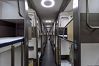 Two-level bunks with curtains.
