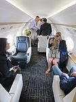 Interior of Gulfstream G550 cabin with passengers.JPG
