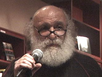 2011 in poetry - Ira Cohen reading at Rapture Cafe NYC on Feb 3, 2007, his 72nd birthday
