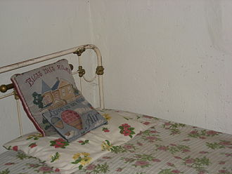 """Is This Love (Bob Marley & The Wailers song) - Bob Marley's bed in Nine Mile, Jamaica, which was the inspiration for """"We'll share the shelter of my single bed"""" in the song """"Is This Love""""."""