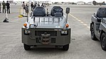 JGSDF 2.5t class aircraft towing tractor(Toyota L&F 2TG25) front view at Camp Akeno November 4, 2017.jpg