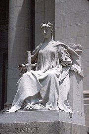 Lady Justice or Justitia is a personification of the moral force that supposedly underlies the legal system. Her blindfold symbolizes equality under the law through impartiality towards its subjects, the weighing scales represent the balancing of people's interests under the law, and her sword denotes the law's force of reason and the power of the sovereign to enforce the law.