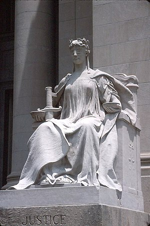 Lady Justice or Justitia is a personification of the moral force that underlies the legal system. Her blindfold symbolises equality under the law through impartiality towards its subjects, the weighing scales represent the balancing of people's interests under the law, and her sword denotes the law's force of reason.