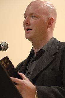 York reading one of his poems in March 2007
