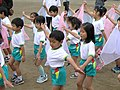 Japanese day care students performing at their sports day.JPG