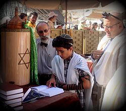 Jewish boy reads Bar Mitzvah.JPG