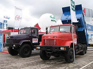 KrAZ - KRAZ trucks Moscow, Russia at MIMS 2006. Vehicles are KrAZ-65032 dump truck (red truck) and KrAZ-6140TE semi-trailer truck.