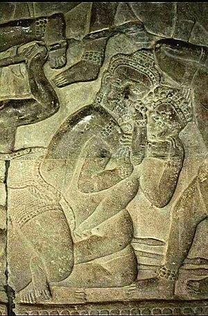 Rear naked choke - Khmer bas relief of rear naked choke hold.