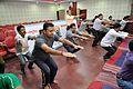 Knee Movement - Loosening Practice - International Day of Yoga Celebration - NCSM - Kolkata 2015-06-21 7311.JPG