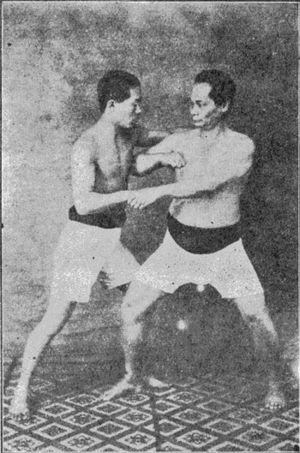 Kickboxing - Tatsuo Yamada (left) and his master, Choki Motobu (right)