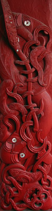 Tall wooden carving showing Kupe above two tentacled sea creatures