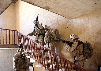U.S. Marines from 3rd Battalion 3rd Marines clear a house in Al Anbar Governorate. L company 3rd Battalion 3rd Marines search house.jpg
