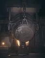 Ladle of molten iron is poured into an open hearth furnace for conversion into steel, Allegheny Ludlum Steele Corp, Brackenridge, Pa Note the safety latch on the crane hook.jpg