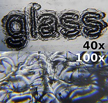 Laser engraved glass microscope slide at 40x and 100x magnification.