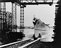 Launch of USS Topeka (CL-67) at the Fore River Shipyard, Quincy, Massachusetts (USA), on 19 August 1944 (NH 42047).jpg