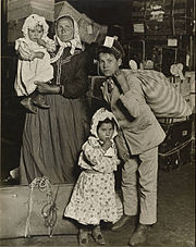 Lewis W. Hine - Immigrant Family in the Baggage Room of Ellis Island - Google Art Project.jpg
