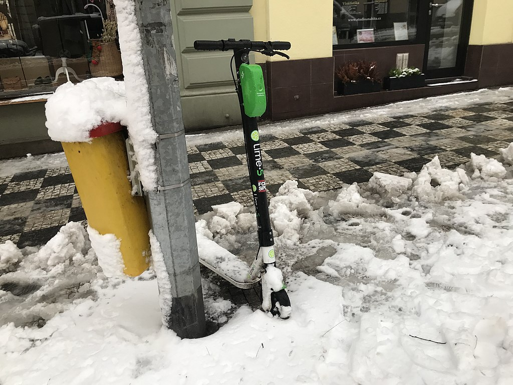 LimeBike scooter, snowy Prague
