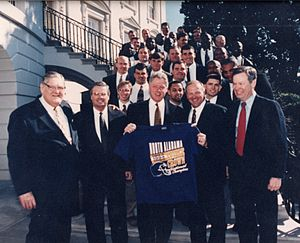 North Alabama Lions - Coach Bobby Wallace, UNA President Robert Potts, and members of the 1995 National Championship team pose with President Bill Clinton and U.S. Senator Howell Heflin at the White House.