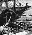 Loading ship with square timber through the bow port Quebec City QC 1872.jpg