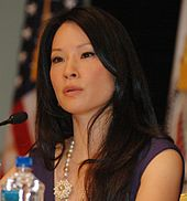 Liu speaking at the USAID Human Trafficking Symposium in September 2009.