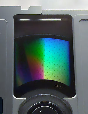 Magneto-optical drive - A Magneto-optical disc and the numerous rectangles on its surface.