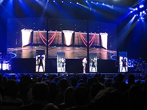 "4 Minutes - Madonna and her dancers emerge from behind the moving screens for the performance of ""4 Minutes"" on the Sticky & Sweet Tour."