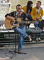 Man playing guitar in Behai Park.jpg