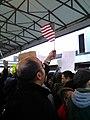 Man with flag at Atlanta protest.jpg