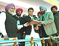 Manish Tewari being presented a memento by the officials of Grewal Sports Association, during the Kila Raipur Rural Sports festival, in District Ludhiana on February 01, 2013.jpg