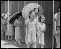 Manzanar Relocation Center, Manzanar, California. Evacuees of Japanese ancestry lining up outside t . . . - NARA - 537969.tif