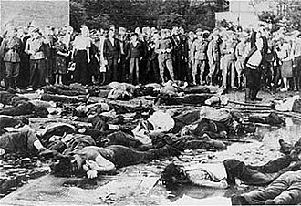 Kovno Ghetto - Civilians looking at the massacre of 68 Jews in the Lietukis garage of Kaunas on June 25 or 27, 1941