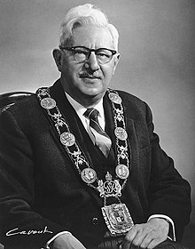 Portrait of Mayor Phillips, seated, wearing the mayor's chain of office