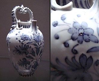 Medici porcelain - Medici Porcelain Works, Bottle, c. 1575–87, with pitted texture detail; Soft Paste Porcelain; OA 2734, Musée du Louvre, Paris.