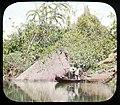 Men in boat on river (3607563431).jpg