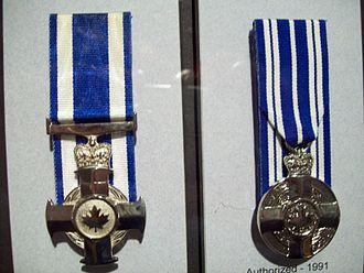 Meritorious Service Decoration - The Meritorious Service Cross, Military (left) and the Meritorious Service Medal, Civil (right).