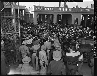 Bracero program - Mexican workers await legal employment in the United States, 1954